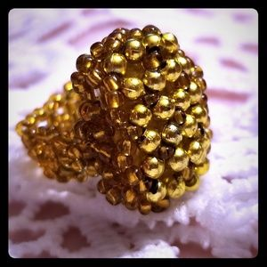 Handmade, gold-beaded ring